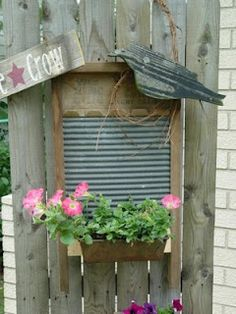 Old Washboard...with a flower box & a prim crow.