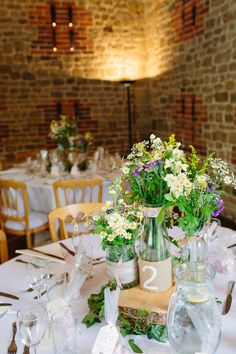 Log Jar Flowers Centrepiece Rustic Country Garden Barn Yellow Navy Wedding http://hayleysavagephotography.co.uk/