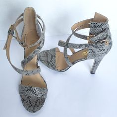 "MO68 STRAPPY Gray Sandals Size 9.5 New These Sexy MO68 Sandals are Faux Snake skin texture.  There are 4"" inches high.  Size 9.5 New. 🎉I accept reasonable offers!  🚫NO TRADES!🚫 MO68 Shoes Heels"