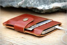 LEATHER IPHONE WALLET | BY SAKATAN LEATHER We recently found this Etsy online store named Sakatan Leather. They manufacture beautifully crafted leather products, our pick is this stylish leather iPhone wallet, it can carry your iPhone and features a slot for money and credit card, closed by an elegant strap. The case is made by order and can be customized for any type of phone.