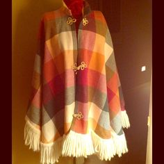 VINTAGE FRINGED PLAID PONCHO Bright Mod plaids with thick yarn fringe!  A few stains of unknown source are on the inside as shown but are not seen from the outside of fabric. Small hole at shoulder is not noticed because of all the color distractions and overall COOLNESS of this AWESOME piece!!!!! handmade Jackets & Coats