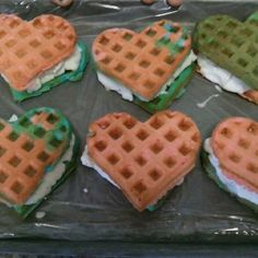 Homemade ice cream sandwiches using a box cake mix (made per instructions), a waffle maker, and ice cream.  Made them for our 4th of July party.  Freeze on cookie sheet before wrapping in plastic wrap.  We are going to make orange waffles next for an orange creme sandwich.