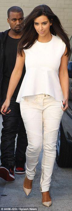 Celebrity couple Kim Kardashian and Kanye West in their signature black and white ensembles