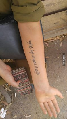 Friend got this tattoo in Elvish language(lord of the rings), she says it doesn't say something special but she only told her mom...