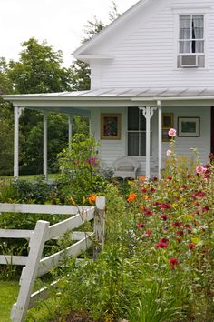 white farmhouse and country garden