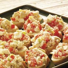Feta Artichoke Bites  You can prepare the flavorful topping for this appetizer ahead of time. Then spread onto slices of bread and broil for a fast, festive snack.