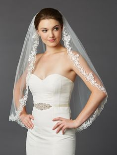 With scalloped lace edging, crystals and floral vines, this L and w fingertip bridal veil boasts intricate ivory cording. The beauty of the ornate lace adorning this wedding veil is easily admired against the subtly sheer tulle. Fingertip Veil, Mantilla Veil, Lace Weddings, Wedding Veils, Wedding Dresses, Bridal Veils, Trendy Wedding, Wedding Ideas, Wedding Planning