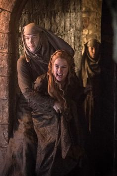 Queen Cersiei being thrown into prison by one of The High Sparrow's followers.
