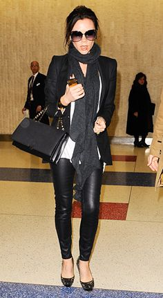 February 8, 2011 As she left John F. Kennedy International Airport in NYC, the fashionista sported a white top, a black blazer, Victoria Beckham denim pants, Victoria Beckham sunglasses, Christian Louboutin spiked heels and a bag from her Fall 2011 collection.