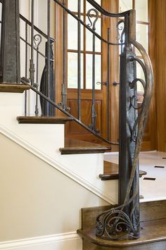 Hand-forged Railing & custom air vent in Craftsman Home by Maynard Studios
