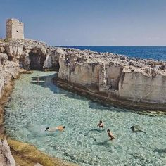 Beautiful crystal clear water in a natural pool in Puglia, Italy. Visit Italy in. Beautiful crystal clear water in a natural pool in Puglia, Italy. Visit Italy in your imagination w Places Around The World, Oh The Places You'll Go, Places To Travel, Travel Destinations, Places To Visit, Around The Worlds, Tourist Places, Travel Tours, Travel Guides