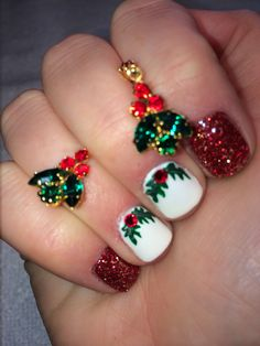 Gel nails with hand painted Christmas holly berries Swarovski as red berries and artiglio glitter-ginger
