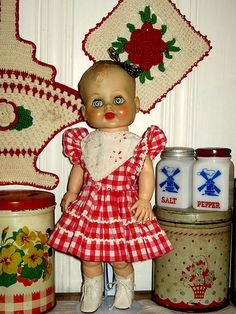 old doll in kitchen