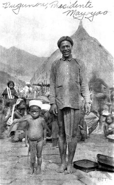 Headman of a Mayoyao group, with boy, North Central Luzon Island, Philippines, early 20th Century