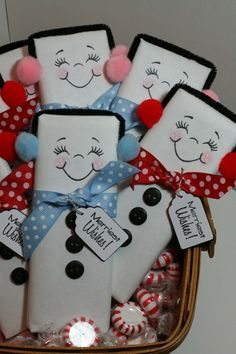 Wrap a full sized chocolate bar with white wrapping paper and draw on the faces. For the earmuffs, use a black pipe cleaner and  pom poms. Use buttons or black puffy paint and a cute ribbon and tag to complete the look. Really cute idea!