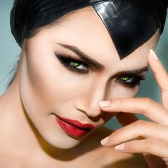 The movie's lead character, Maleficent, is the inspiration for this look made with dark smokey eye makeup, heavy cheek contouring and red lipstick. The products used awaits you.