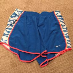 Brand new nike running shorts Brand new Nike running shorts in blue with pink, yellow and white accents. Never worn!! Nike Shorts