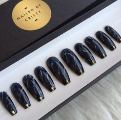 Black Marble press on nails with small gold accent at the tips. Available in any shape & size. Choose a 10 Nail set or a Full Set of 20 nails (All Sizes) if unsure of sizing. Sizes: XS, S, M, L XS: THUMB 3, POINT 6, MIDDLE 5, RING 7, PINKY 9 S: THUMB 2, POINT 5, MIDDLE 4, RING 6, PINKY 9 M: THUMB 1, POINT 5, MIDDLE 4, RING 6, PINKY 8 L: THUMB 0, POINT 4, MIDDLE 3, RING 5, PINKY 7 FULL SET: You receive 20 nails size 0-9. With your order you will also receive a mini nail file, orange wood...