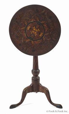 "Federal cherry candlestand, ca. 1790, retaining an early decorated surface, 27"" h., 17 3/4"" d."