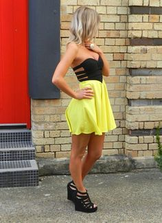 black and yellow sweetheart deep cut dress.