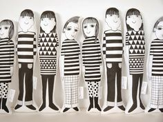 From Jane Foster Blog. Screen-printed dolls, each with their own personality.