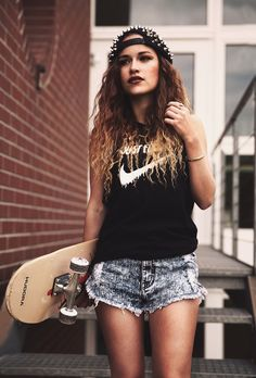 Studded cap, nike shirt, cool shorts, waffled hair, dark lips, tanned and carrying a skateboard. swag