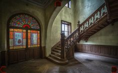 CHÂTEAU POSEIDON, FRANCE A large abandoned house in France with stained glass windows, a nice timber staircase and carved wood ceilings. Timber Staircase, Staircase Design, Stairs, Derelict Places, Abandoned Places, Abandoned Mansions, Abandoned Buildings, Traditional Staircase, Houses In France