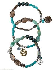 Keep this trio of Quartzite, Pyrite, Glass, Agate, Pearl, Brass, Shell and Sterling Silver Stretch Bracelets in your bag of tricks.