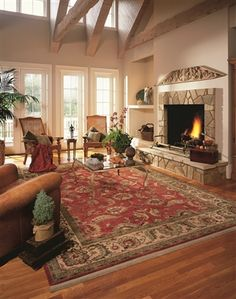 We love this warm inviting area rug by karastan..It will make any living room, den, or even bed room feel rich and welcoming. Made from 100% New Zealand wool with ten sizing options order your so day.  gottalottarugs.com
