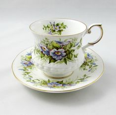 Vintage bone china tea cup and saucer by Queen's Rosina China. Tea cup is white with ribbing and decorated with wild flowers. Gold trimming on cup and saucer edges. Excellent condition (see photos). Markings read: Queen's Fine Bone China Made in England Rosina China Co Ltd Wild Flowers