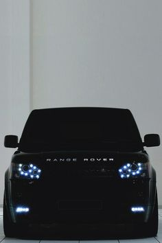 Luxury. Car. SUV. Black & Blue. City. Street. Range Rover. Industrial. Design. Robust. Headlights. Safe.
