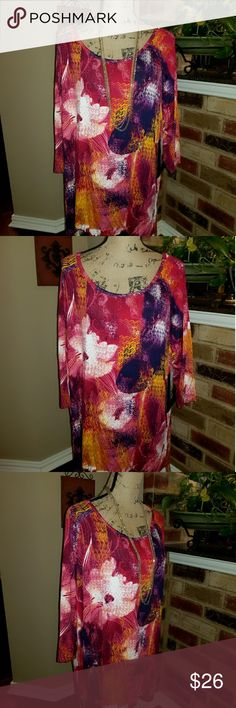 """🌺Gorgeous Floral Tunic Bright and Rich Tunic Style Plus size Top that is so rich in colors and quality. 95 % Viscose which is so soft and rich. 5% spandex for extra stretch. Rose colored sequins shimmer the flowers lightly. Bust measures 26 in across. Length 30"""" in front and Back 33"""". Top does drop lower in back. Slits on each side. NWT. Onque Casuals Tops Tunics"""