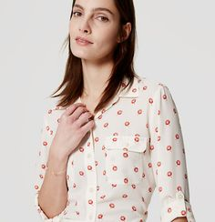 With a vibrant floral print, roll-tab sleeves give this refined essential its modern attitude. Point collar. Long sleeves with button cuffs and roll-cuff button tabs. Button through flap patch pockets. Shirttail hem.