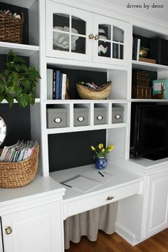 Home office bookcase with black backdrop and skirt under desk to hide cord clutter
