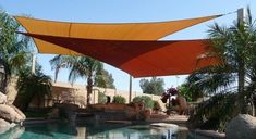 "For backyard shade -- a creative alternative to a covered patio or large outdoor umbrellas are ""sail shades"" hung at different heights and angles over the patio, pool or sitting area. They look great, block out most harmful rays and can be taken down in the Winter. Houzz photo, Tenshon."