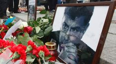 Photos, flowers and candles are left in memory of Boris Nemtsov, who was recently murdered in Moscow, in Independence Square in Kiev, February 28, 2015. Russia's Investigative Committee is pursuing several lines on inquiry following the murder of opposition politician Boris Nemtsov, including the possibility it was an attempt to destabilise the political situation, Interfax news agency said. REUTERS/Valentyn Ogirenko (RUSSIA - Tags: POLITICS CRIME LAW) - RTR4RJ3L http://pronewsonline.com