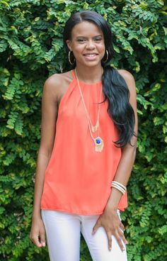 Bright and fun! We can't get enough of our Sweet Lily Top - Orange. This look has a thin tank strap with a high neckline and swing fit at the waist. Perfect for Summer cookouts and late night football games!