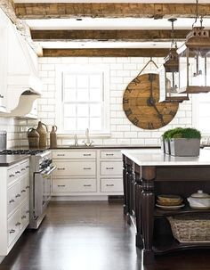 Rustic Farmhouse Kitchen...white on white...rugged beams...OVERSIZED RUSTIC CLOCK. LOVE IT!!!