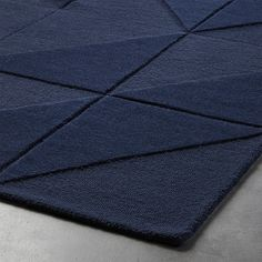 Shop Nora Navy Tufted Rug. Plush navy triangles form tonal blue geometrics underfoot. Designer Bryn E. Namavari drew inspiration from tile making and quilting—mediums that piece together shapes in fresh configurations.