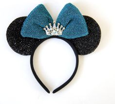 Mickey/ Minnie Mouse inspired Ears  Minnie Mouse inspired Princess ears features a blue bow with flecks of glitter detailing adorned with a tiara *made of