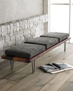 Bench is handcrafted of reclaimed South American hardwoods with natural wax and black finish. Cushions are covered with canvas and may be embellished with letters and patches with different colored stitching. Photo: Horchow, Horchow.com