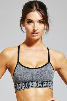 """A low-impact sports bra crafted from a marled stretch knit with removable cups, adjustable straps, a Y-back, and a """"Be Strong. Never Stop"""" graphic."""