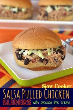 Slow Cooker Salsa Pulled Chicken Sliders (with Avocado Lime Crema) are a perfect appetizer recipe for game day, made easier with your crockpot! | cupcakesandkalechips.com