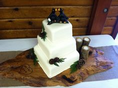 Rustic themed, 3 tiered wedding cake covered with fondant & decorated with pine cones & cedar sprigs.  Loved the kissing bears!  One of my very most favorites of all time!  It was fun to make.