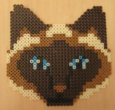 https://flic.kr/p/8eAhHn | Siamese cat head Perler Beads | This is an old cross stitch pattern. I have actually done it in threads. I should post a photo of it in floss for comparison.