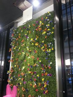 Artificial Boxwood hedge used to bake a stunning hedge flower wall