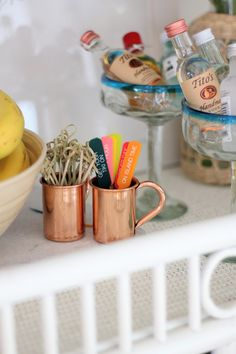 Happy Hour in Paradise: Summer Bar Cart Styling | House Full of Summer - Florida bar cart decor, tropical themed party, tiki bar styling, coastal decor dining room entertaining, LVP wood floors, fresh palm fronds, palm leaves, giant bird of paradise, Bar Cart Styling, Bar Cart Decor, Coastal Homes, Coastal Decor, Decorating On A Budget, Porch Decorating, Place Settings, Table Settings, Palm Fronds