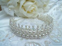 inch high and was created using 4mm, 6mm, 8mm white glass pearls, 6mm and 8mm machine cut crystals