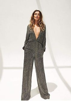 424193c2552 Rachel Zoe Mavis Jumpsuit Inspired by decades past this wide leg sequin  jumpsuit features allover sequin embellishments. Features a V-neckline with  an open ...