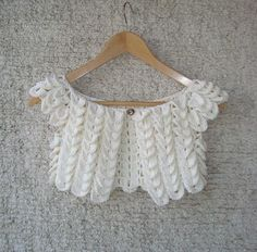 Looks like crocodile stitch.  It's pretty. No pattern, but I might be able to figure it out.  At least something similar.